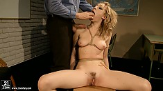 She's tied up and he jams his cock in her mouth and rubs her clit